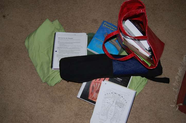 The detritus of the day: my mess of massage therapy school supplies.