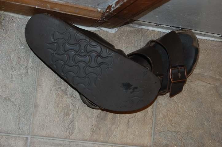 Sandals at the door.